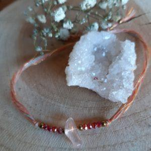 leuk verstelbaar armbandje in koraal kleur met kleine steentjes