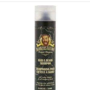 zwarte fles met loigo barberstation erop (man met baard) shampoo voor je haar en je baard