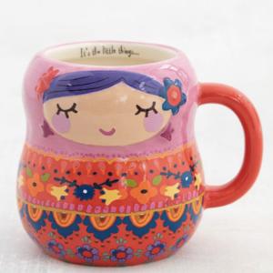 super leuke mok met een gezichtje van een meisje erop en beschilder met leuke en vrolijk bloemen! oranje/roze/blauw