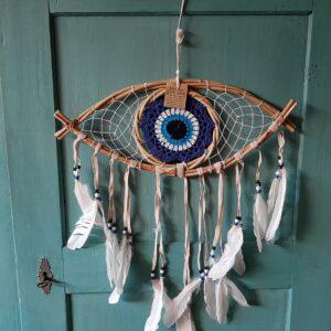 dromenvanger oog met veren eraan